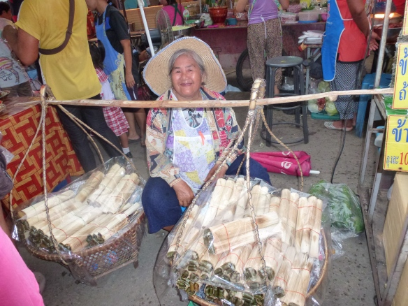 A hardworking but happy street seller